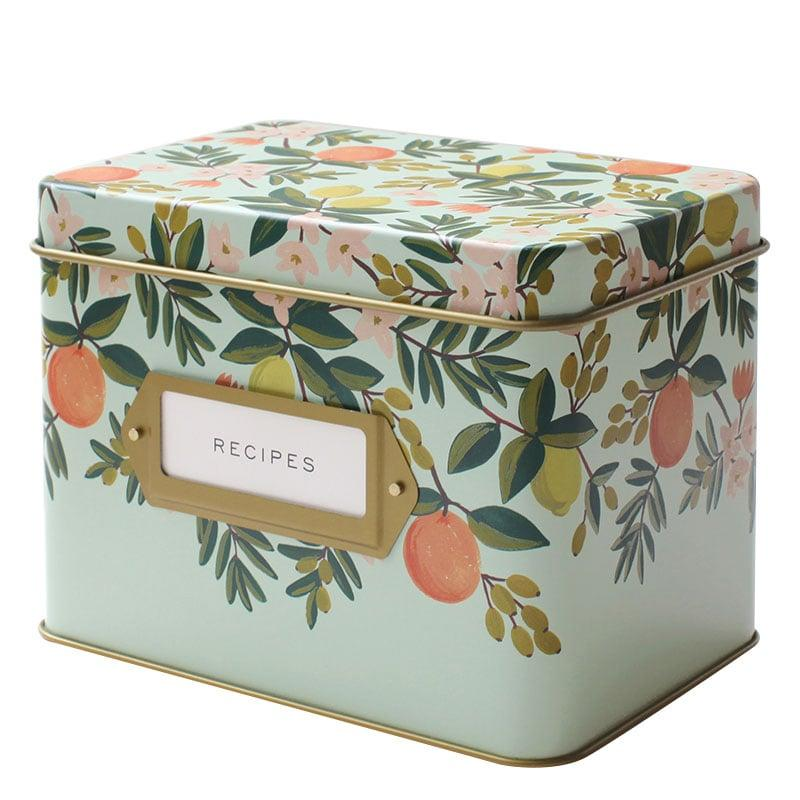 """<p><a href=""""https://www.popsugar.com/buy/Rifle-Paper-Co-Citrus-Floral-Recipe-Box-381399?p_name=Rifle%20Paper%20Co.%20Citrus%20Floral%20Recipe%20Box&retailer=amazon.com&pid=381399&price=34&evar1=tres%3Aus&evar9=20856918&evar98=https%3A%2F%2Fwww.popsugar.com%2Flove%2Fphoto-gallery%2F20856918%2Fimage%2F36153315%2FRecipe-Box&list1=family%2Cgifts%2Choliday%2Cthanksgiving%2Cchristmas%2Cgift%20guide%2Crelationships%2Choliday%20living%2Cgifts%20under%20%24100&prop13=mobile&pdata=1"""" rel=""""nofollow"""" data-shoppable-link=""""1"""" target=""""_blank"""" class=""""ga-track"""" data-ga-category=""""Related"""" data-ga-label=""""https://www.amazon.com/Rifle-Paper-Co-Recipe-Box/dp/B00GQHEFY8?th=1"""" data-ga-action=""""In-Line Links"""">Rifle Paper Co. Citrus Floral Recipe Box</a> ($34)</p>"""