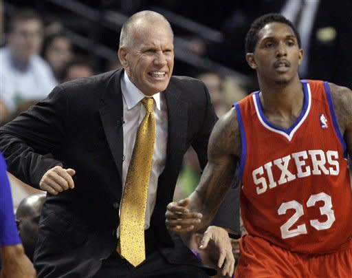 Philadelphia 76ers coach Doug Collins reacts on the sidelines with guard Lou Williams at right during the second quarter of Game 7 against the Boston Celtics in an NBA basketball Eastern Conference semifinal playoff series, Saturday, May 26, 2012, in Boston. (AP Photo/Elise Amendola)