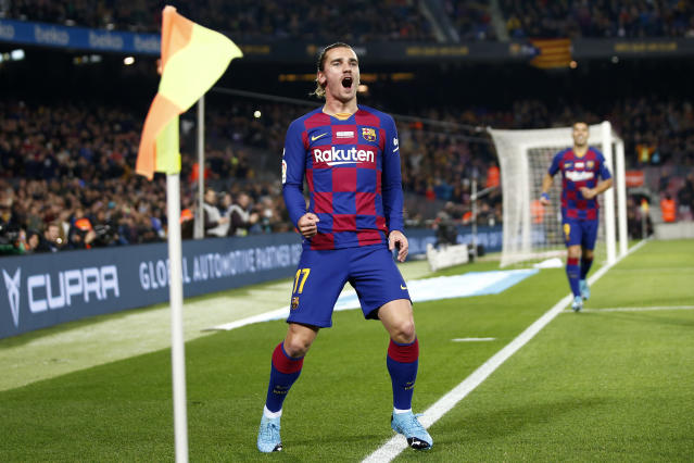 Barcelona's Antoine Griezmann celebrates after scoring the opening goal during a Spanish La Liga soccer match between Barcelona and Mallorca at Camp Nou stadium in Barcelona, Spain, Saturday, Dec. 7, 2019. (AP Photo/Joan Monfort)