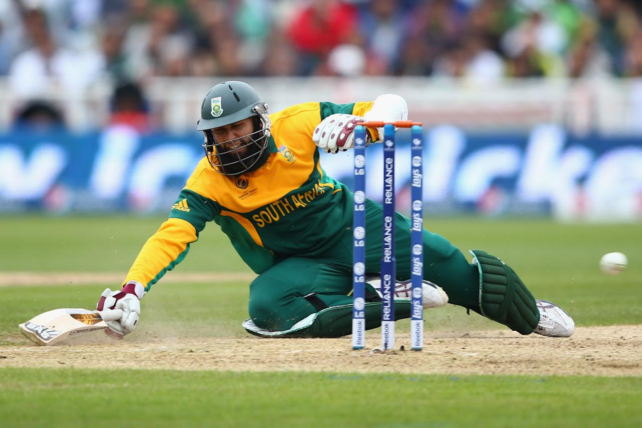BIRMINGHAM, ENGLAND - JUNE 10:  Hashim Amla of South Africa dives to make his ground going for a quick single during the ICC Champions Trophy Group B match between Pakistan and South Africa at Edgbaston on June 10, 2013 in Birmingham, England.  (Photo by Michael Steele/Getty Images)
