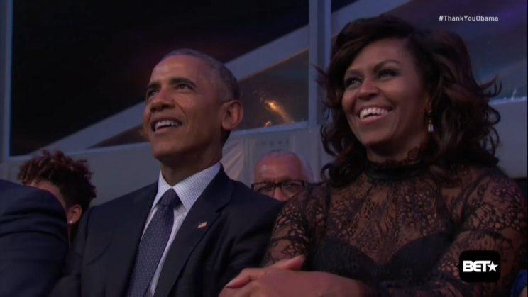 Barack and Michelle Obama taking in BET's