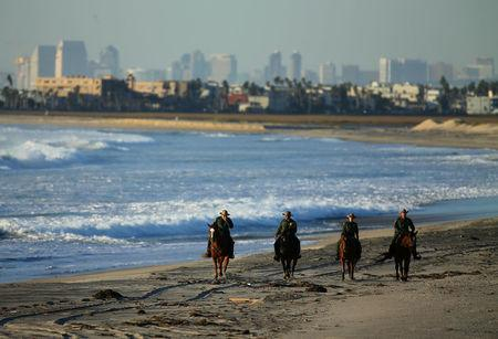 U.S. Border Patrol agents on horseback patrol along a beach just north of the U.S.-Mexico border near San Diego, California, U.S., November 10, 2016. REUTERS/Mike Blake