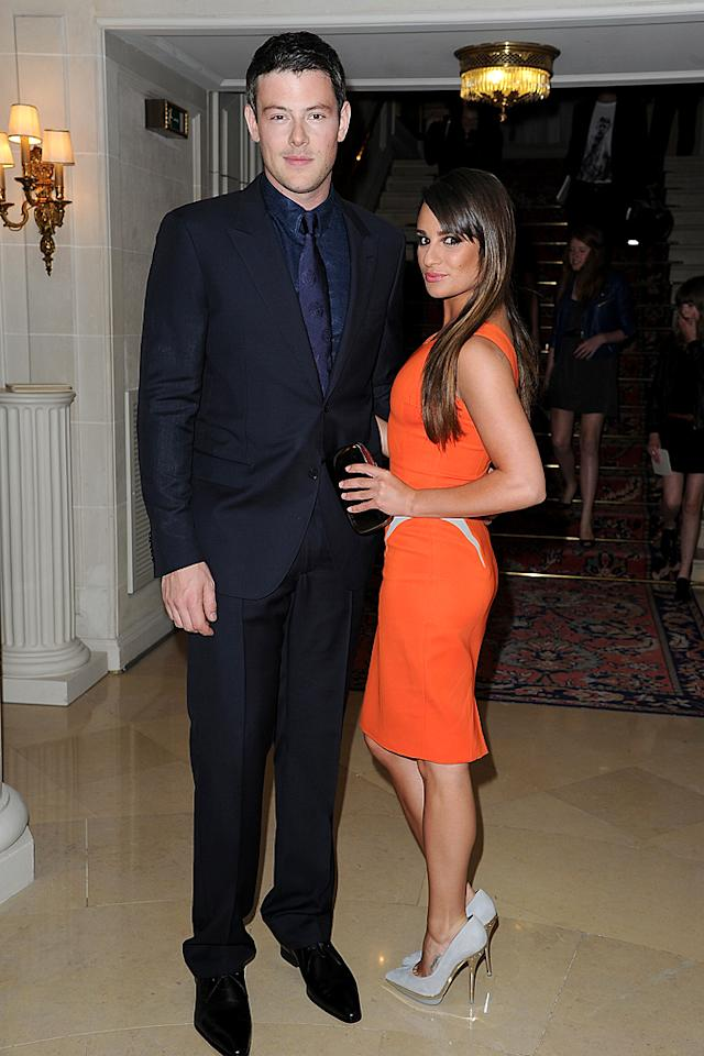 "ADORABLE ALERT! Like most of Tinseltown, ""Glee"" co-stars (and real-life couple) Cory Monteith and Lea Michele have been seen out and about in the City of Light this week. Upon arriving at the Versace showcase, the dynamic duo posed for this photo. Cory looked dapper in his navy blue suit and baroque shirt-and-tie combo, while Lea looked tantalizing in a tangerine cocktail frock and gray suede Versace heels. How cute are they?! (7/1/2012)"