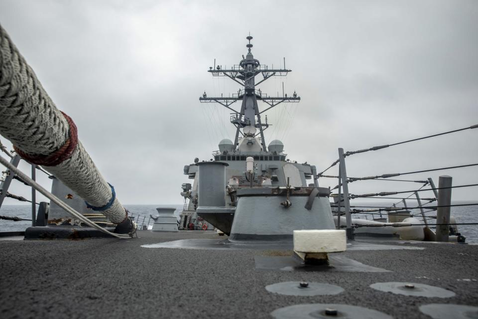 In this photo released by the U.S. Navy, the U.S. Arleigh Burke-class guided-missile destroyer USS Curtis Wilbur (DDG 54) conducts routine operations in the Taiwan Strait, May 18, 2021. China on Thursday, May 20, 2021, issued its second protest in as many days over United States naval activity in the region, drawing an unusually sharp response from the U.S. 7th Fleet, which accused Beijing of attempting to assert illegitimate maritime rights at the expense of its neighbors. (Mass Communication Specialist 3rd Class Zenaida Roth, U.S. Navy via AP)