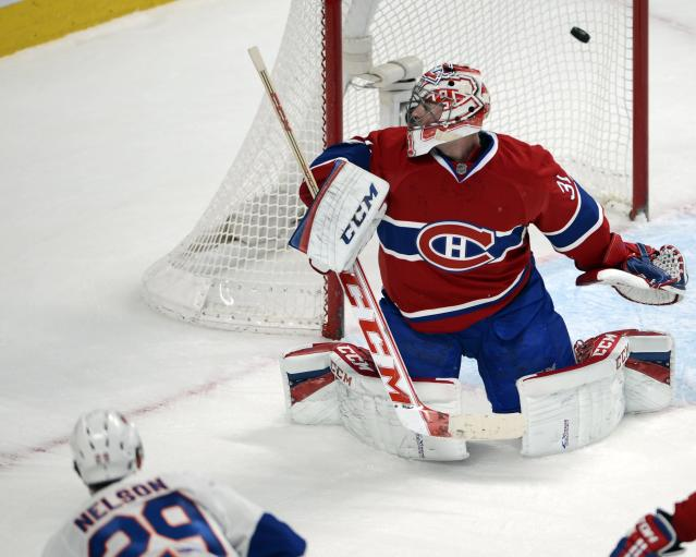 New York Islanders center Brock Nelson (29) scores against Montreal Canadiens goalie Carey Price during the second period of an NHL hockey game Thursday, April 10, 2014, in Montreal. (AP Photo/The Canadian Press, Ryan Remiorz)