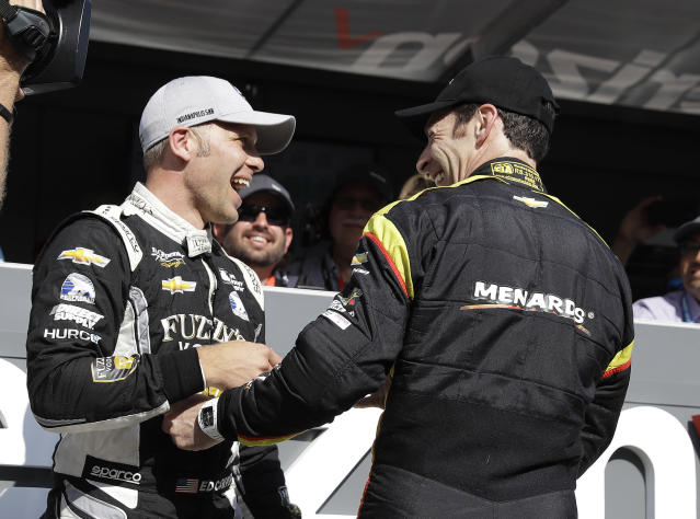 Ed Carpenter, left, is congratulated by Simon Pagenaud, of France, after winning the pole for the IndyCar Indianapolis 500 auto race at Indianapolis Motor Speedway in Indianapolis Sunday, May 20, 2018. (AP Photo/Darron Cummings)