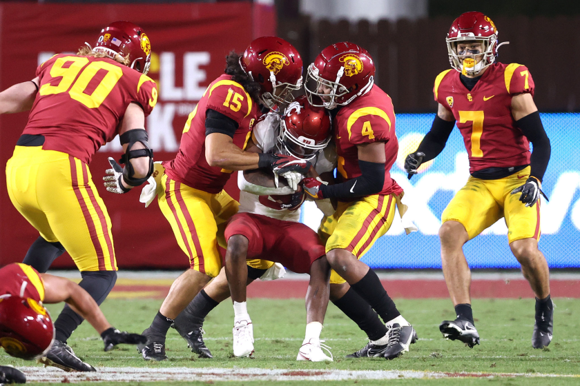 LOS ANGELES, CALIFORNIA - DECEMBER 06: Max Williams #4 and Talanoa Hufanga #15 of the USC Trojans.