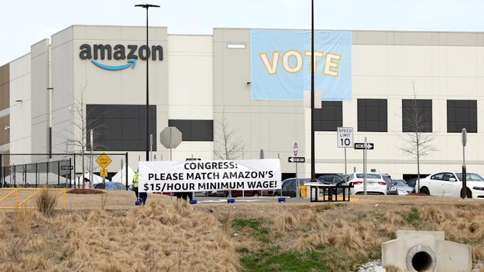 Banners at the Amazon facility in Bessemer, Ala., in March to show their support for workers who will vote on whether to unionize. (Dustin Chambers/Reuters)