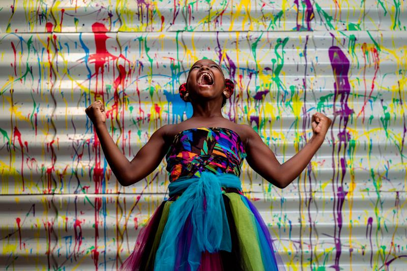 Marian Scott is pictured yelling into the air while wearing a colourful dress. Source: https: Jermaine Horton