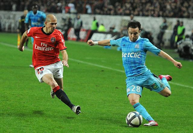 Marseille's player Mathieu Valbuena fights against Paris-Saint-Germain's Christophe Jallet on November 7, 2010 during their French League 1 football match at the Parc des Princes stadium in Paris. PSG won 2-1 AFP PHOTO / MIGUEL MEDINA (Photo credit should read MIGUEL MEDINA/AFP/Getty Images)