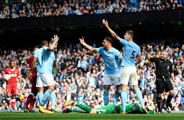 <p>Kyle Walker of Manchester City and John Stones of Manchester City gesture for the Manchester City medical team as Ederson of Manchester City goes down injured after a challenge from Sadio Mane </p>