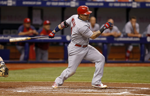 St. Louis Cardinals' Yadier Molina follows through on a single that scored two runs during the third inning of a baseball game against the Tampa Bay Rays Wednesday, June 11, 2014, in St. Petersburg, Fla. (AP Photo/Mike Carlson)