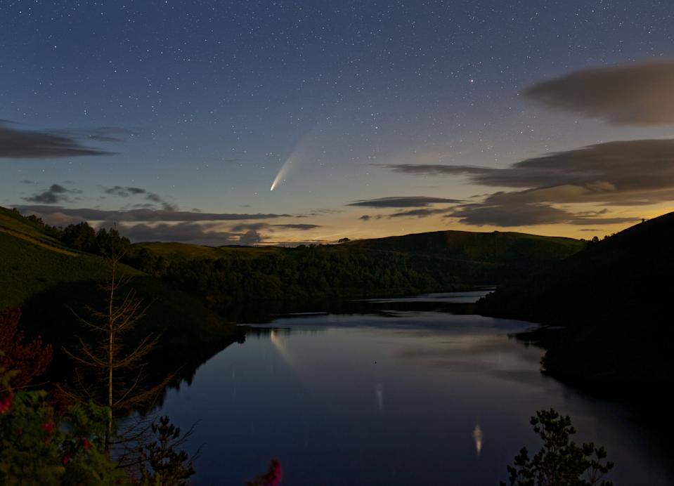 Comet Neowise passes over lake Vymwy in Wales on 11 July 2020. See SWNS story SWBRcomet.