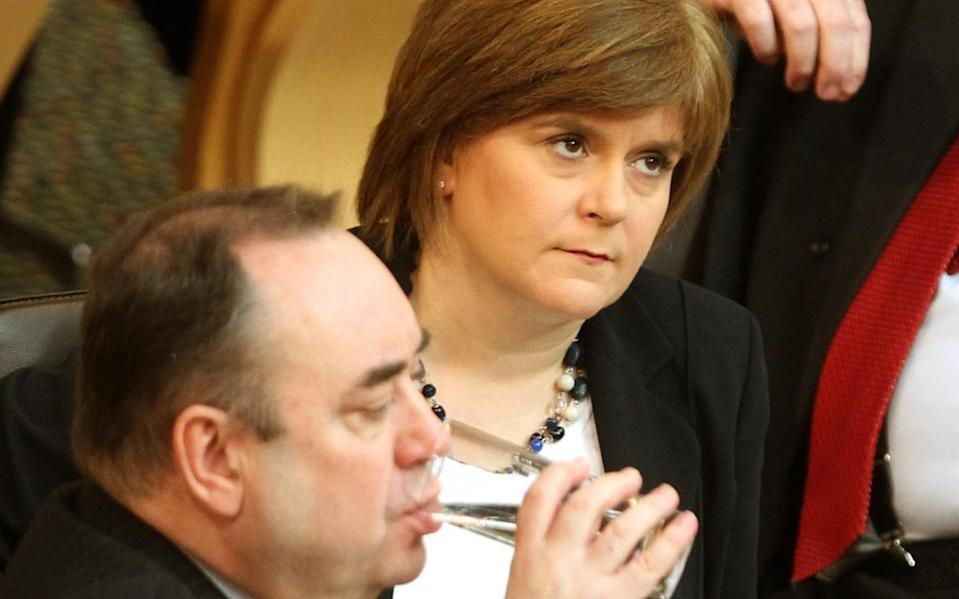 File photo dated 23/02/12 of the then Deputy First Minister Nicola Sturgeon (top) with then First Minister Alex Salmond during First Minister's Questions at the Scottish Parliament in Edinburgh. Former first minister Alex Salmond, giving evidence before the Committee on the Scottish Government Handling of Harassment Complaints , has said there has been