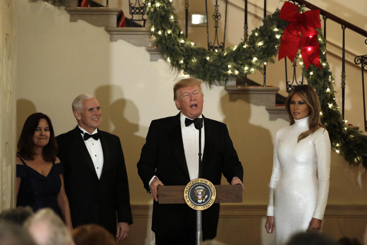 President Trump speaks while first lady Melania Trump and Vice President Mike Pence and his wife, Karen Pence, look on at the White House Congressional Ball on Dec. 15, 2018. (Photo: Yuri Gripas-Pool/Getty Images)
