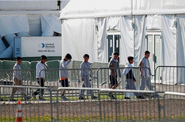 PHOTO: Children line up to enter a tent at the Homestead Temporary Shelter for Unaccompanied Children in Homestead, Fla., Feb. 19, 2019. (Wilfredo Lee/AP, FILE)