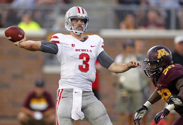 UNLV quarterback Nick Sherry (3) throws against Minnesota in the second quarter of their NCAA college football game, Thursday, Aug. 29, 2013, in Minneapolis. (AP Photo/Andy Clayton-King)