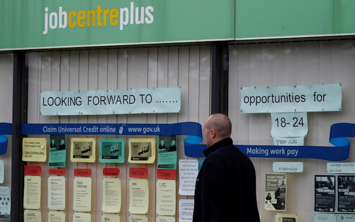 A man walks past a job centre in Manchester following the outbreak of the coronavirus disease. - Phil Noble/Reuters