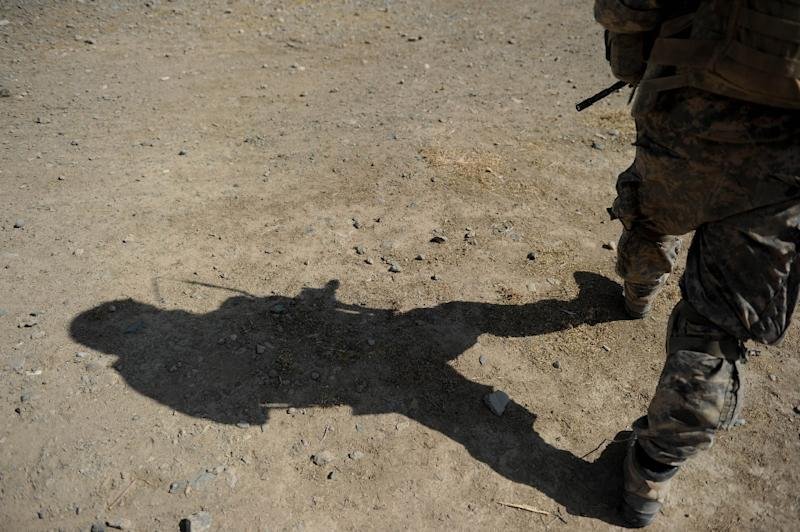 A Romanian soldier was killed in a Taliban claimed suicide attack on a NATO convoy in southern Afghanistan that also wounded two others, officials said