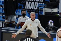 Southern California head coach Andy Enfield reacts to a call during the first half of a Sweet 16 game against Oregon in the NCAA men's college basketball tournament at Bankers Life Fieldhouse, Sunday, March 28, 2021, in Indianapolis. (AP Photo/Jeff Roberson)