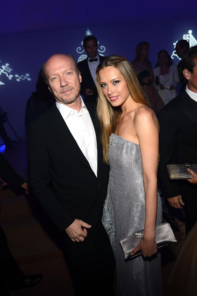 CANNES, FRANCE - MAY 18:  Paul Haggis and Petra Nemcova attend the Haiti Carnival in Cannes Benefitting J/P HRO, Artists for Peace and Justice & Happy Hearts Fund Presented By Armani during the 65th Annual Cannes Film Festival on May 18, 2012 in Cannes, France.  (Photo by Michael Buckner/Getty Images)