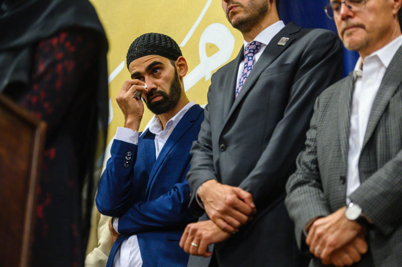 FILE - In this Aug. 11, 2019, file photo, Hamid Hayat wipes tears as he stands with his legal team, and family members during a news conference Sunday that coincided with an Eid al-Adha celebration, in Sacramento, Calif. Federal prosecutors in California on Friday, Feb. 14, 2020, ended what once was among the nation's highest profile anti-terrorism cases, after a judge earlier overturned Hayat's conviction that grew from conspiracy allegations in the wake of the 2001 terrorist attacks. Hayat, a cherry picker from the community of Lodi, Calif., was freed in August after spending more than 14 years in prison. (Daniel Kim/The Sacramento Bee via AP, File)