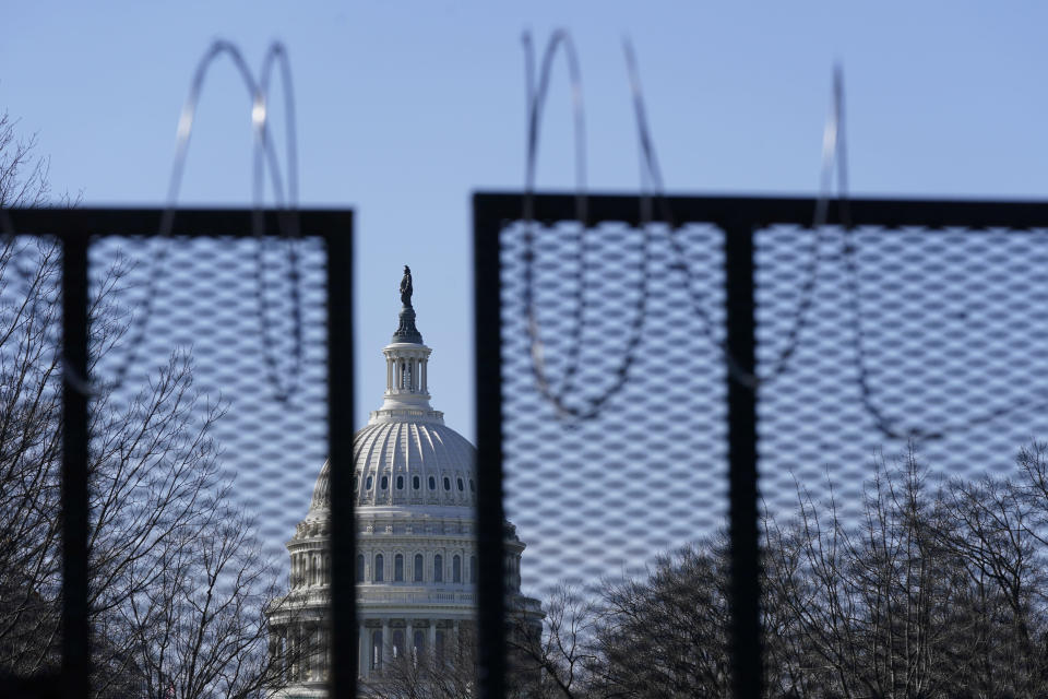 FILE - In this March 20, 2021, file photo the U.S. Capitol dome stands past partially-removed razor wire hanging from a security fence on Capitol Hill in Washington. Authorities suggested for weeks in court hearings and papers that members of the Oath Keepers militia group planned their attack on the Capitol in advance in an effort to block the peaceful transition of power. But prosecutors have since said it's not clear whether the group was targeting the Capitol before Jan. 6, giving defense attorneys an opening to try to sow doubt in the government's case. (AP Photo/Patrick Semansky, File)