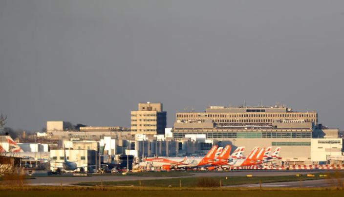 FILE PHOTO: Easyjet and British Airways planes are pictured at Gatwick airport