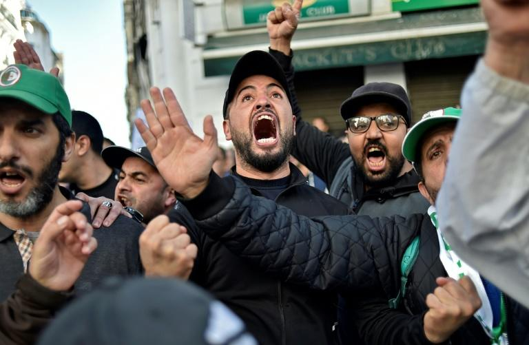 Arabic and French hashtags including #FreeDemocraticAlgeria and#TheyMustAllResign have gone viral online, echoing chants in Algeria's streets as protesters urge a boycott of the presidential poll (AFP Photo/RYAD KRAMDI                        )