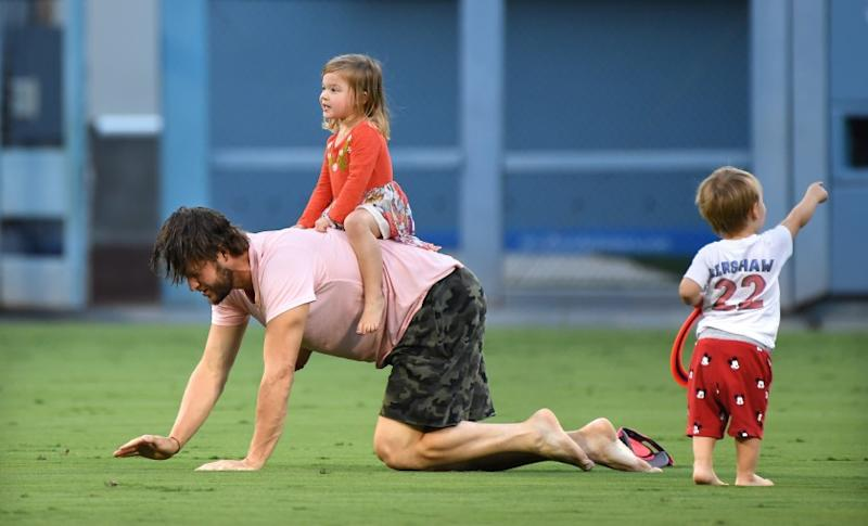 LOS ANGELES, OCTOBER 1, 2018-Dodgers pitcher Clayton Kershaw plays with his children after his team