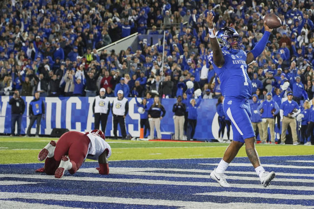 Kentucky quarterback Lynn Bowden Jr. (1) celebrates after scoring a touchdown in the first half of the team's NCAA college football game against Arkansas, Saturday, Oct. 12, 2019, in Lexington, Ky. (AP Photo/Bryan Woolston)