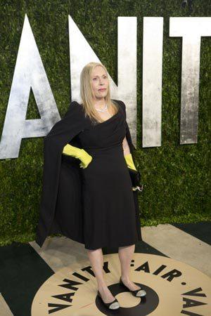 "<p>Accessorising a black cape with yellow leather gloves, the actress turned heads for her unusual outfit choice at the 2013 Vanity Fair Oscar Party. Dunaway Tweeted ""Not attending the #Oscars tonight, but will be at the #VanityFair after party. Have a great day all.""</p>"