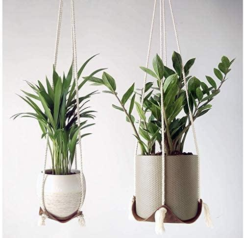 <p>You don't have to transfer your plants into a new pot with these <span>Genuine Leather Plant Hangers, Set of 2</span> ($26).</p>