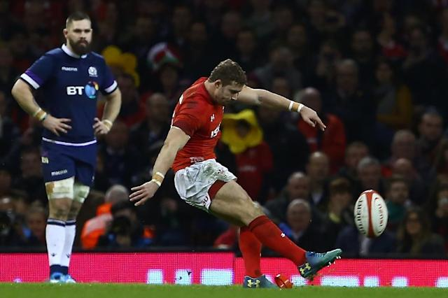 Wales' full-back Leigh Halfpenny (R) kicks a penalty during their Six Nations rugby union match against Scotland, at the Principality Stadium in Cardiff, on February 3, 2018 (AFP Photo/Geoff CADDICK)