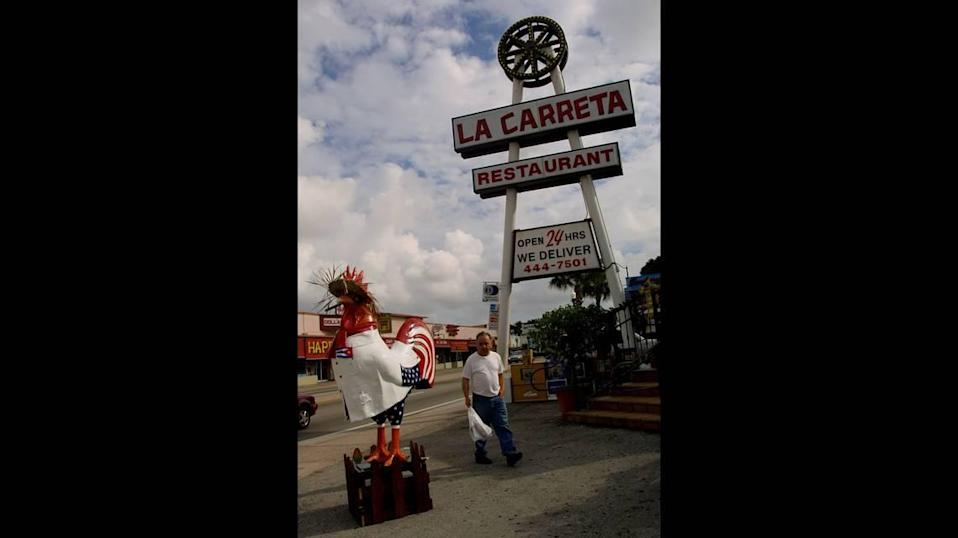 The rooster that was clad in a guayabera and straw hat in front of La Carreta, 3632 SW Eighth St., in 2002 was a López rooster.