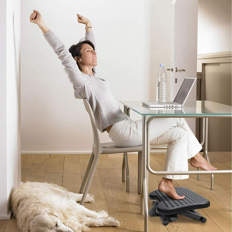 Woman using an adjustable foot rest to help improve posture while she works from home.