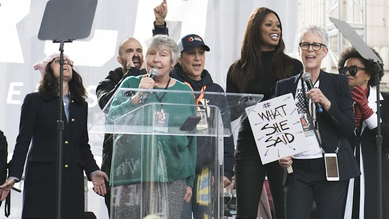 Reddy with celebrities including Jamie Lee Curtis at a Women's March in 2017