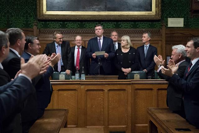 Sir Graham Brady (centre), chairman of the 1922 Committee, announces that Theresa May has survived (PA)