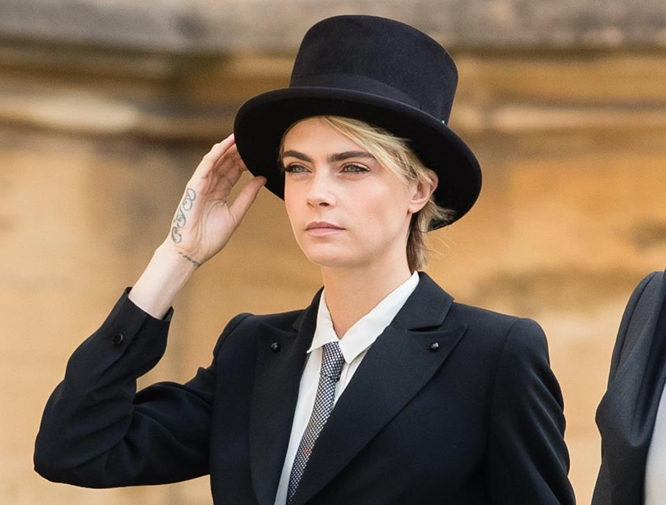 <p>Delevingne's honey blond hair peeped out from under her top hat, making a major style statement (and defying royal style traditions) at <span>Princess Eugenie's wedding at the end of 2018</span>.</p>