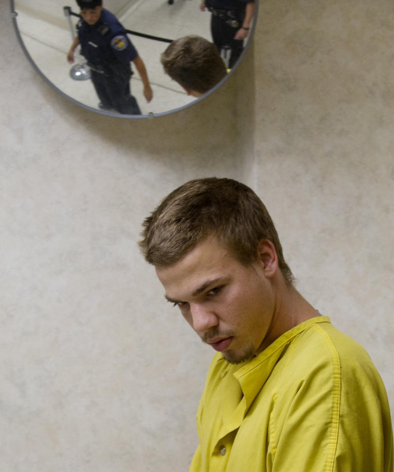 Ryan Dougherty is escorted to court for an appearance in Pueblo, Colo., on Monday, Aug. 15, 2011. The filing of charges against the three fugitive siblings captured in Colorado has been delayed until next week. (AP Photo/Pool, Mike Sweeney)