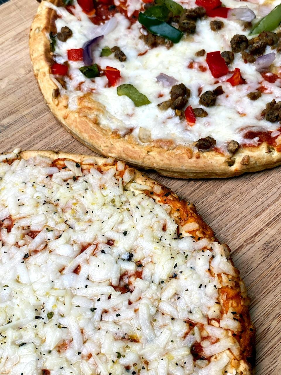 <p>Here's what the Banza frozen pizzas look like after cooking. The Supreme pizza took 16 minutes, and the Plant-Based Cheese took a little longer at 18 minutes.</p>