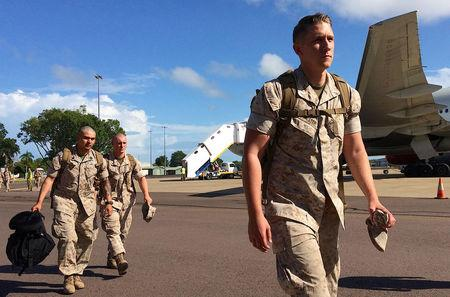 U.S. Marines walk after disembarking a plane after they arrived for the sixth annual Marines' deployment at Darwin in northern Australia