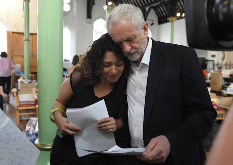 Labour leader Jeremy Corbyn comforts a local resident (name not given) at St Clement's Church in west London where volunteers have provided shelter and support for people affected by the fire at Grenfell Tower. (PA Images)