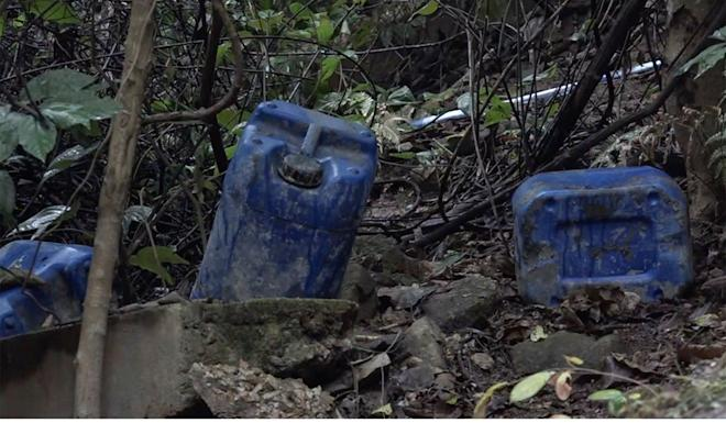 The jerry cans of petrol were stashed on a hillside. Photo: NowTV
