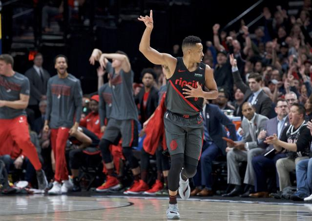 Portland Trail Blazers guard CJ McCollum reacts after making a 3-point basket against the Oklahoma City Thunder during the first half of an NBA basketball game in Portland, Ore., Thursday, March 7, 2019. (AP Photo/Craig Mitchelldyer)