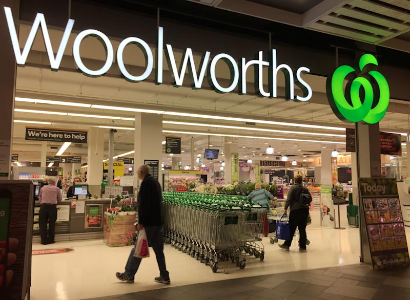 Shoppers walk into a Woolworths supermarket in Sydney, Australia August 22, 2017. REUTERS/Jason Reed