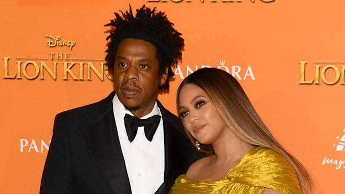 """Jay-Z (left) and wife Beyonce Knowles-Carter attend the July 2019 European premiere of Disney's """"The Lion King"""" at Odeon Luxe Leicester Square in London, England. (Photo by Gareth Cattermole/Getty Images for Disney)"""