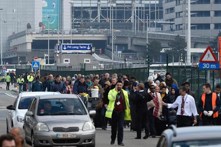 Passengers are evacuated from Brussels airport in Zaventem, on March 22, 2016, after twin blasts rocked the main terminal (AFP Photo/John Thys)