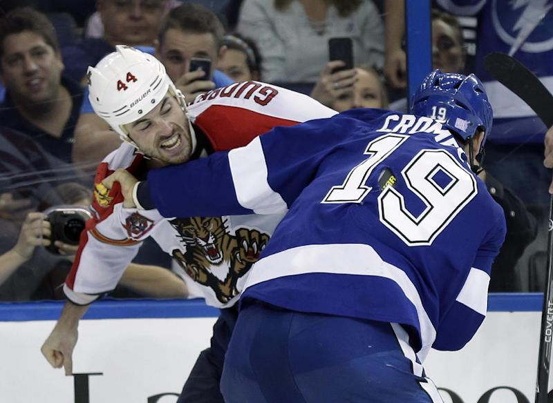 Florida Panthers defenseman Erik Gudbranson (44) and Tampa Bay Lightning right wing B.J. Crombeen (19) fight during the second period of an NHL hockey game Thursday, Oct. 10, 2013, in Tampa, Fla. (AP Photo/Chris O'Meara)
