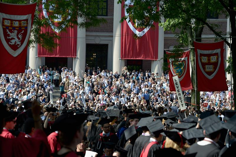 Students attend the Harvard University Commencement Exercises at Harvard University on May 30, 2013 in Cambridge, Massachusetts